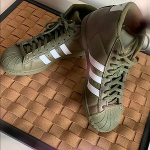 Olive green high top Adidas. Only worn Once !